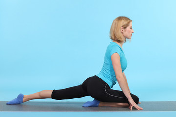 young flexible girl doing yoga