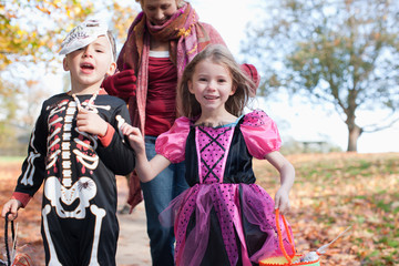 Grandmother with grandchildren in Halloween costumes
