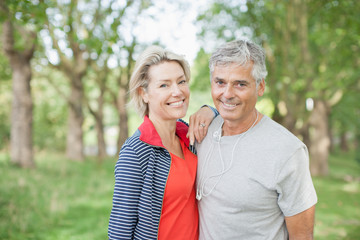 Smiling couple standing together outdoors