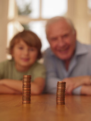 Grandfather and grandson looking coins