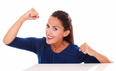 Lovely lady in blue shirt gesturing winning