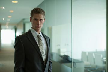 Businessman  in office corridor