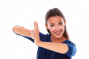 Smiling lady gesturing clapping in victory