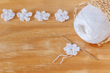 White crochet snowflakes for Christmas decoration