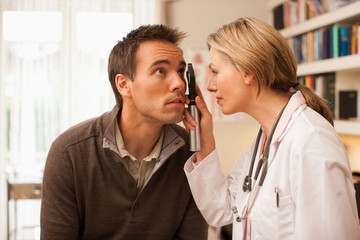 Doctor examining patient's eye in doctor's office