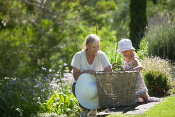 Grandmother and granddaughter looking in basket