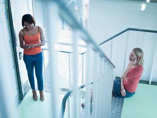 Women talking in stairway