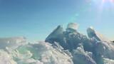 Ice on blue sky background. Slider shot poster