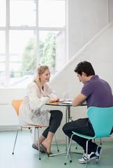 Man and woman talking at table