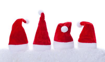 Weihnachtsmützen, Schnee, weißer Hintergrund
