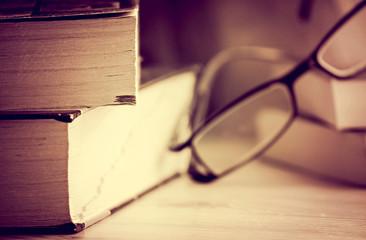 Books and glasses still life, sepia photo