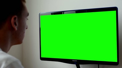 man works on computer - green screen - office - closeup