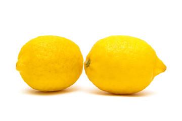 ripe lemons isolated on white background close-up