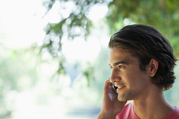 Man standing outdoors and talking cell phone