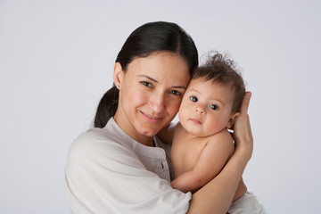 A woman holding a baby