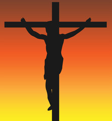 Jesus on the Crucifix with a Sunset Background