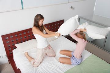 Girlfriends pillow fighting