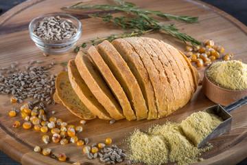 Corn sliced bread on wooden board