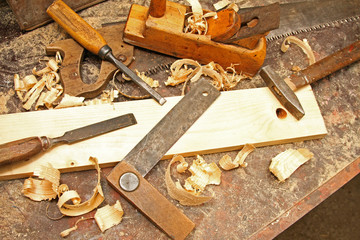 old vintage construction tools on the workbench