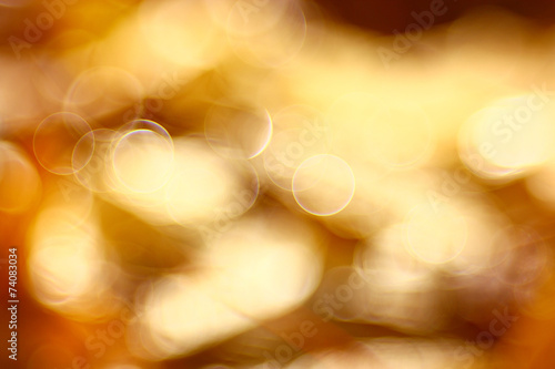 golden orange autumn background blur bokeh, defocusing lens - 74083034