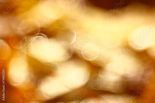 Leinwandbild Motiv golden orange autumn background blur bokeh, defocusing lens