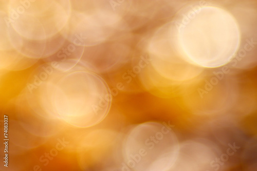 golden orange autumn background blur bokeh, defocusing lens - 74083037