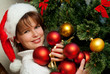 Christmas Woman. New Year and Christmas Tree santa claus hat.
