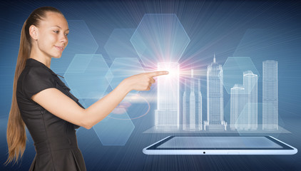 Beautiful businesswoman, tablet pc and spatial layouts of