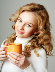 beautiful girl with a cup of tea. the winter season.