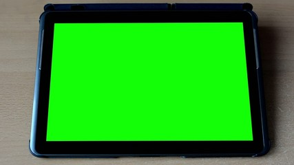 tablet - green screen on the table