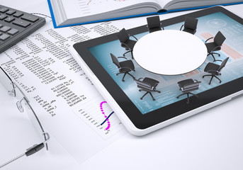 Round table, tablet pc, book, calculator, glasses, paper with