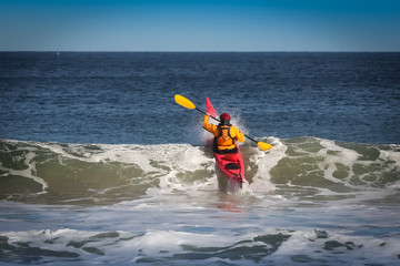 Kayak surfing on sea