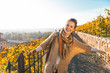 Portrait of happy young woman in autumn outdoors