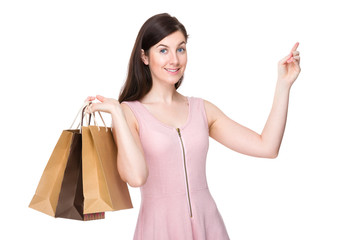 Woman shopping bag and finger point up