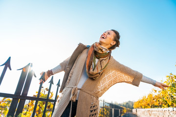 Happy young woman having fun time in autumn outdoors