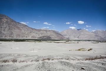 Desert among mountain range