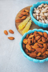 Blue dishes in eastern style with almonds and pistachios
