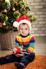 Little boy near Christmas treev