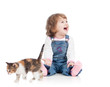 funny happy child playing with cat kitten