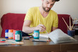 handsome hipster modern man painting