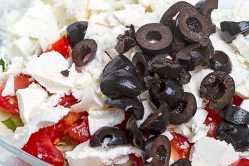 Black olives and mozzarella in a salad