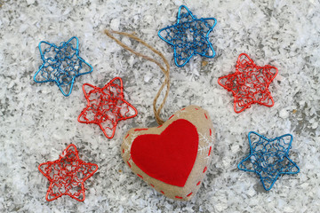 Canvas heart with colorful stars on snowy surface
