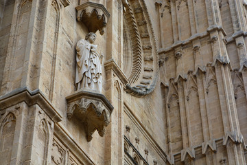 saint statue on old Spanish gothic cathedral facade