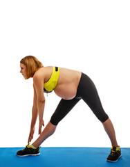 Pregnant woman doing gymnastic exercises
