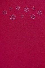 赤いフェルト生地 雪の結晶 背景