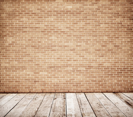 Tall brick wall with wooden floor