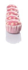 Pink colored steamed rice polka dot muffin or apam polka dot
