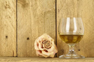Glass of alcohol and dry rose