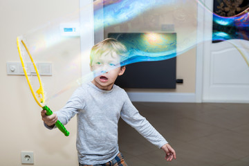 Boy playing with blowing bubbles