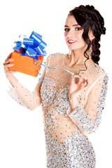 Portrait of a beautiful young woman with a bright gift